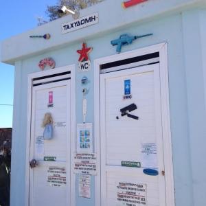 Kitschy door to a public toilet on Iguana Beach in Crete