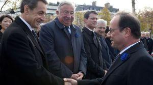 poignee-de-mains-entre-francois-hollande-d-et-nicolas-sarkozy-en-presence-de-jean-yves-le-drian-gerard-larcher-manuel-valls-et-claude-bartolone-lors-de-la-commemoration-de-l-amistrice-le-11-novembre-2015-sur-les-champs-elysees-a-paris_5461328
